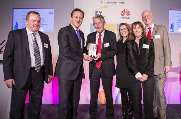 The Prime Minister David Cameron awarding the Growth Award to the Britain is GREAT campaign team