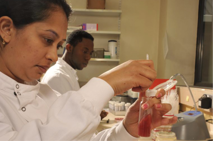 Scientist in a lab mixing something in a test tube