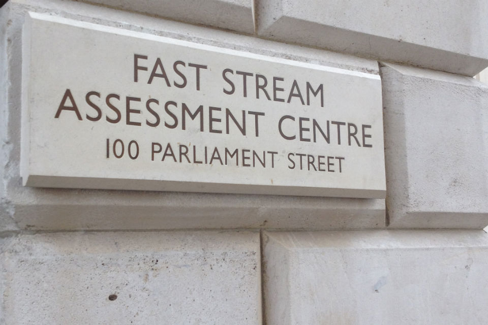 Fast Stream Assessment Centre sign on a wall
