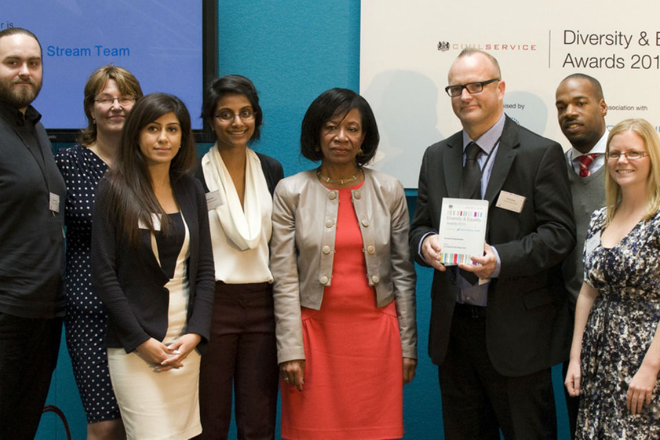 Claudette Sutton presents the Inclusive Employment award to the Civil Service Fast Stream Team at the 2013 Diversity and Equality Awards.