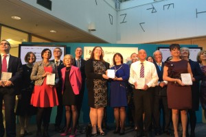The winners of the Diversity and Equality Awards 2014 standing on stage with their awards.