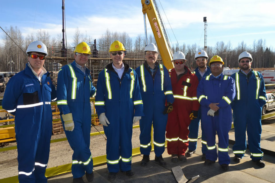 Sir Mark Walport with environmental engineers at Fox Creek