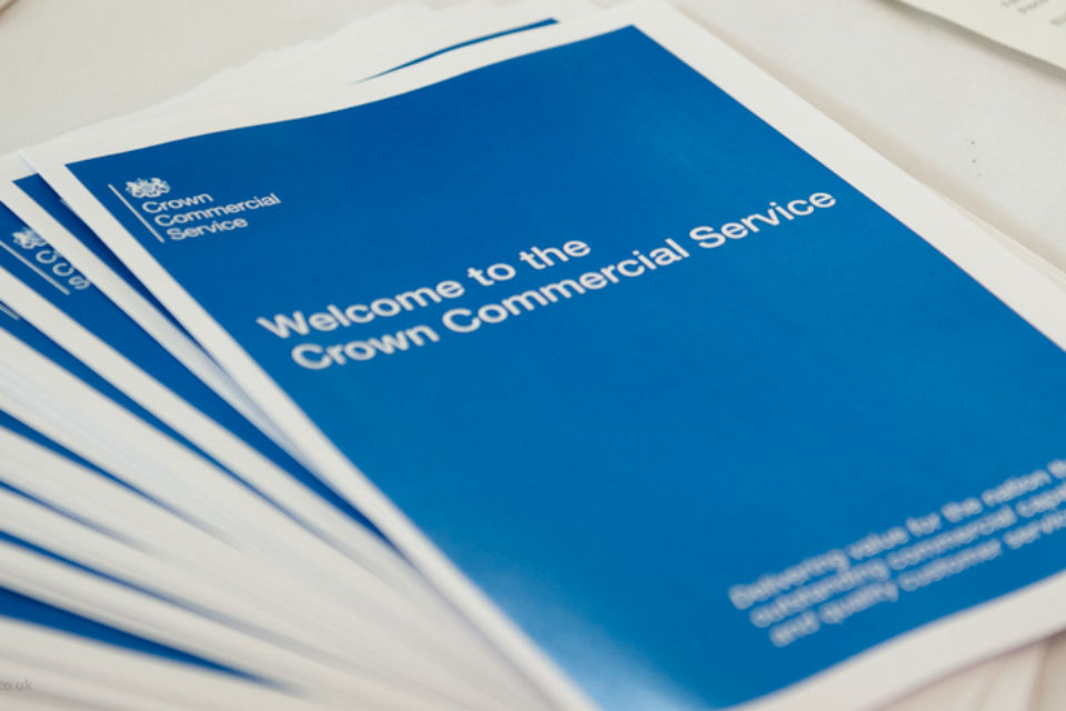 Crown Commercial Service brochures on a table