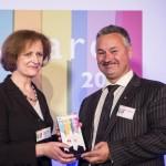 Una O'Brien presenting the Leadership award to Paul Foweather, Governor of Full Sutton Prison at the 2013 Civil Service Awards