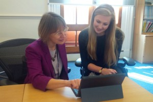 Lin Homer, Permanent Secretary HMRC, working on her laptop with her apprentice Olivia