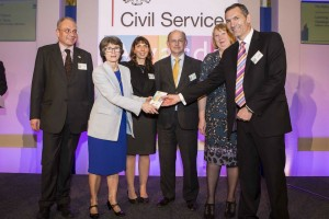 Dstl team being awarded the Skills Award by Bronwyn Hill at the Civil Service Awards 2014
