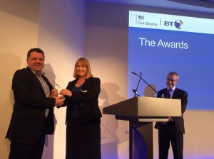 Julie Tankard presenting the Technology Award to MoJ