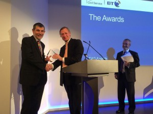 Bruce Mann presenting the  Corporate Leadership Award to DSTL