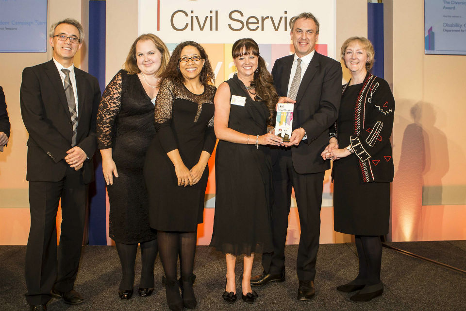 Sir Simon presenting the Diversity Award to the Disability Confident Campaign Team, DWP