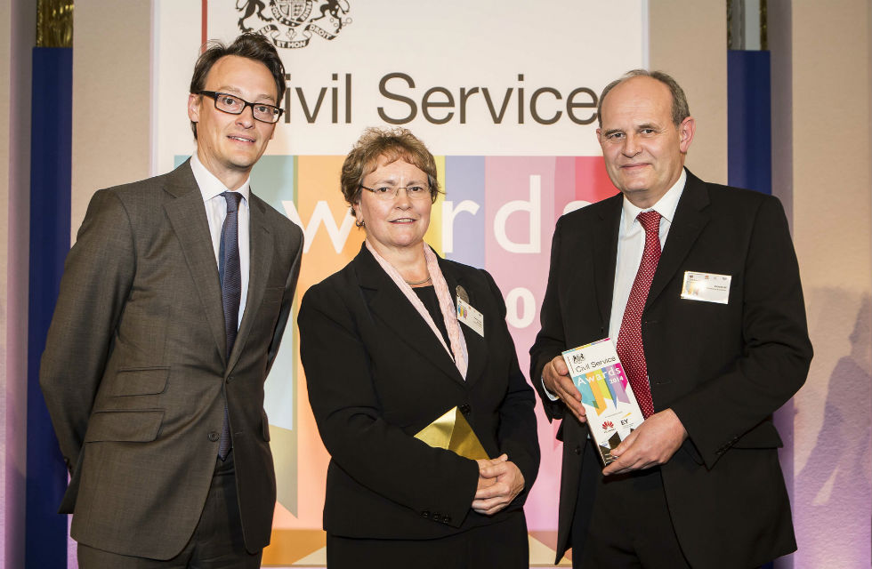 Richard receiving his award from Ursula Brennan, Perm Secretary MoJ