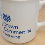 Close-up of a mug with the Crown Commercial Service logo on it