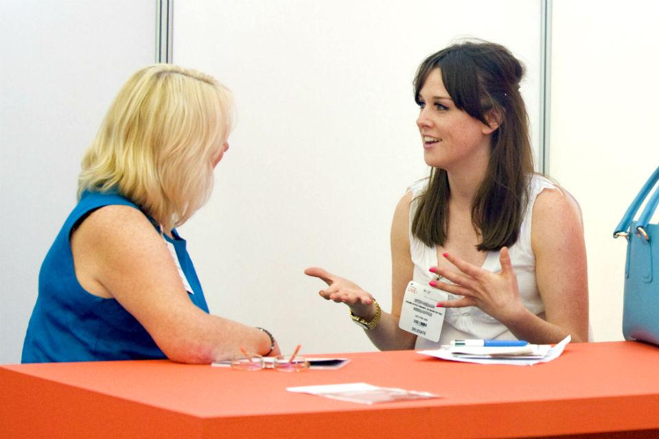 Photo of 2 civil servants chatting
