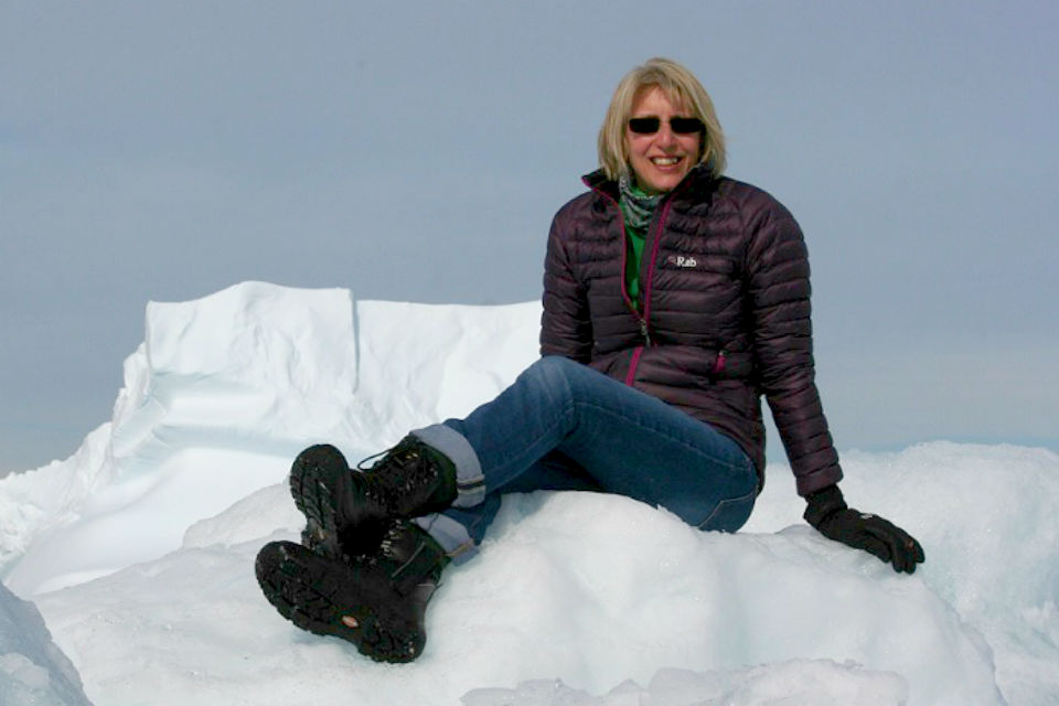 Dr Melody Clark sat on the ice in the Antarctic