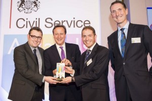 The Prime Minister presenting the Supporting Enterprise & Growth Award  to DECC's Wood Review Report Team at the Civil Service Awards 2014