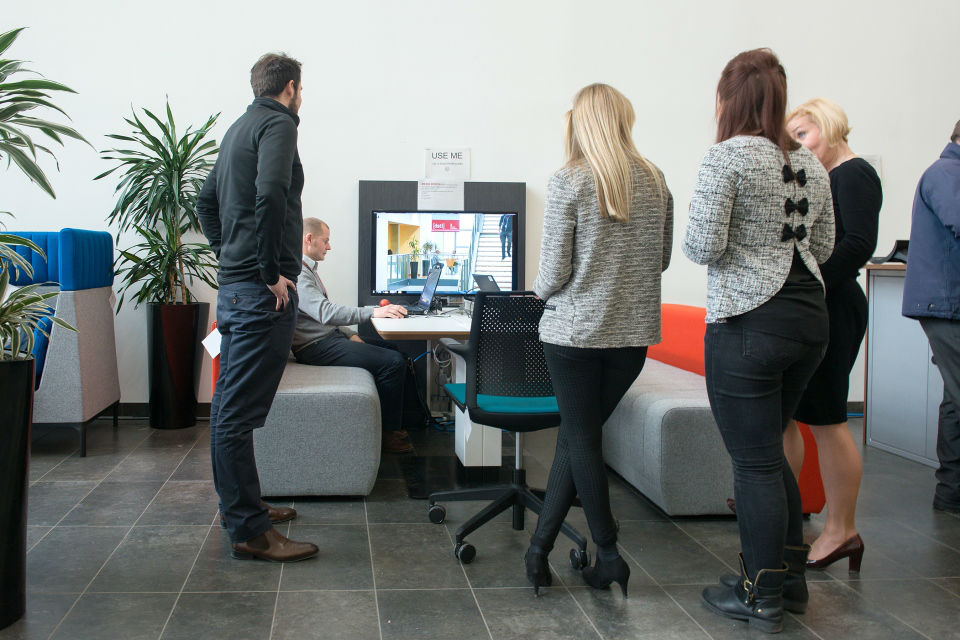 Photo of Dstl staff working in an open plan, hot-desk environment