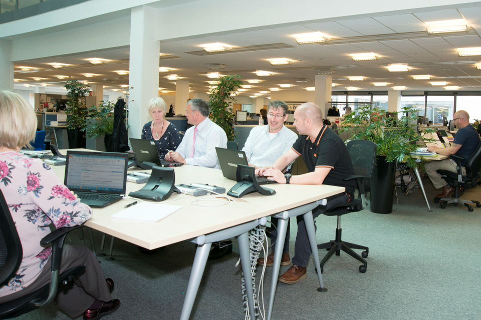Photo of Dstl staff working in paper-free office