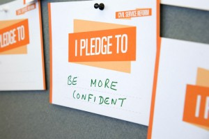 "Pledge card at Civil Service Live 2014 London saying: ""Be more confident"""