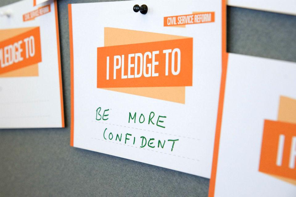 "Pledge card at Civil Service Live 2014 London saying: ""Be more confident"""