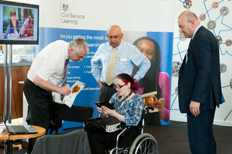 A photo of a disabled colleague at CS Learning's stand at Civil Service Live: Bristol 2014