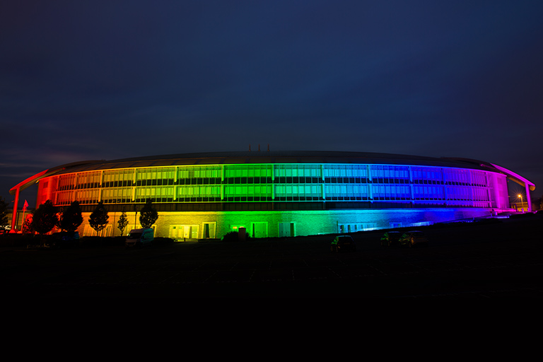 GCHQ lit up with the rainbow colour flag