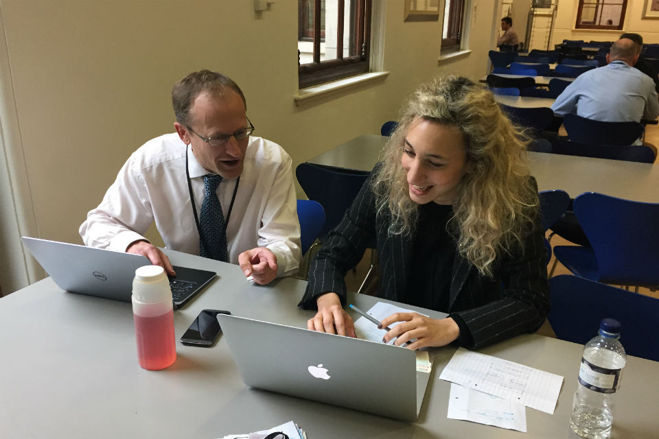 David Phillips and Ariana Demian of the GPU team working in the canteen in 1 Horse Guards