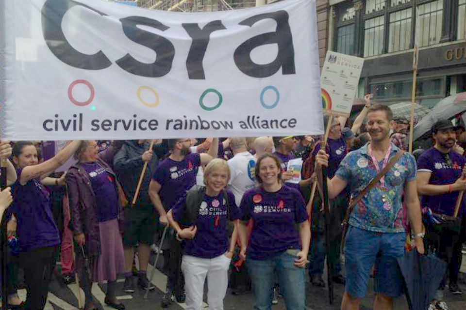 Sue Owen (front, left) and Cabinet Office Permanent Secretary Richard Heaton (front, right) march with CSRA members at Pride