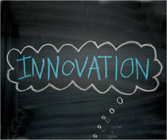 """Blackboard with """"innovation"""" drawn in a thought bubble in chalk"""
