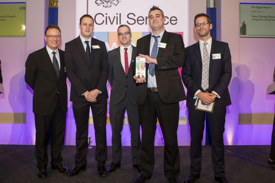 The DVLA digital team winning their Civil Service Award 2014, presented by Richard Heaton (right), Permanent Secretary for the Cabinet Office