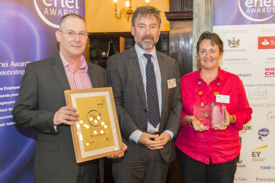 Paul Carswell & Janet Hill from the Civil Service Diversity & Inclusion team collect the Inclusive Culture Award - Public Sector