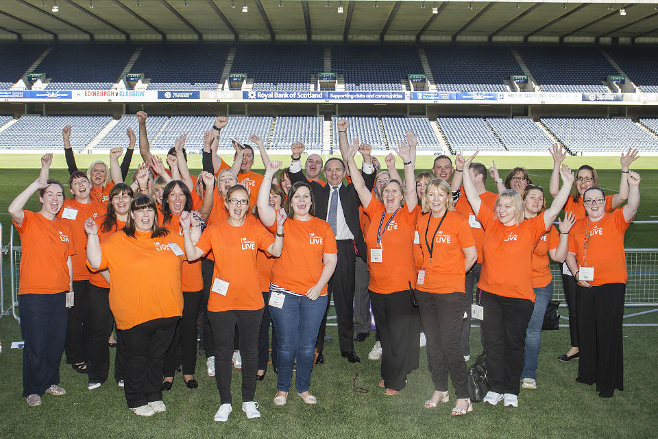 John Manzoni with the Edinburgh volunteers on the pitch at Murrayfield