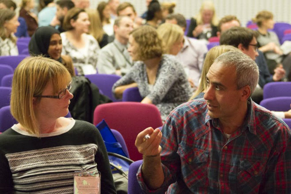 Civil servants in conversation in QEII Conference Centre's Churchill Auditorium at Civil Service Live London 2015