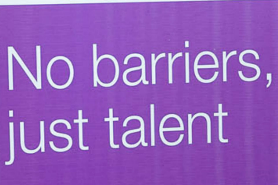 "Detail for banner, with legend ""No barriers, just talent"" in white on a purple background"