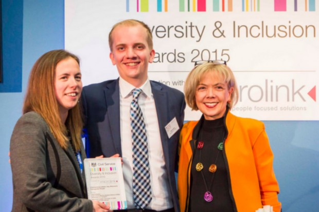 Two women and a man in front of Diversity & Inclusion Awards 2015 banner