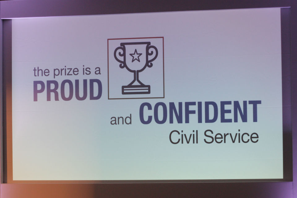 "Slide with a prize cup and words ""the prize is a proud and confident Civil Service"""
