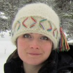 Head shot of Belinda Volans in snowscape wearing woolly hat