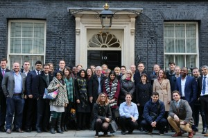 Group shot in front of door of No. 10 Downing Street.