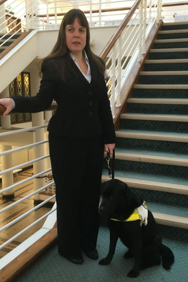 Lisa Boocock with guide dog Bess at her feet