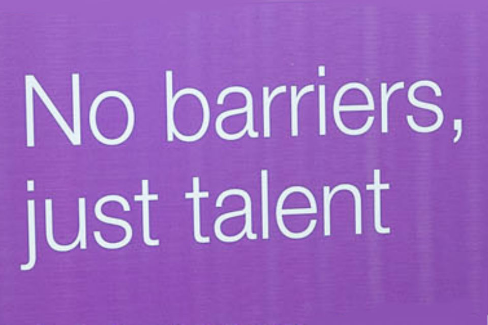 "Legend ""No barriers, just talent"" in white lettering on purple background - detail from display banner"