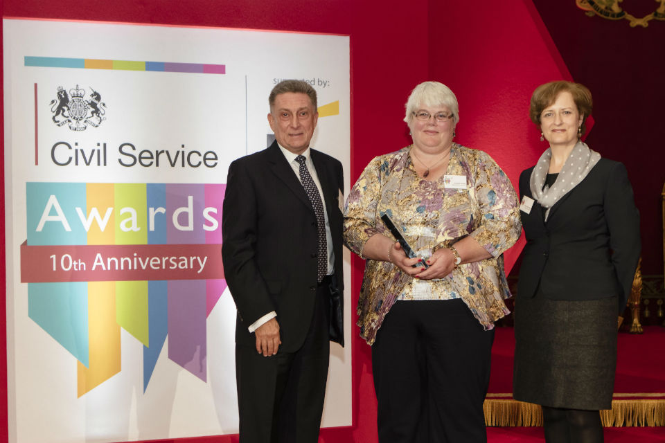 Liz Formby, centre of three, with CS Award