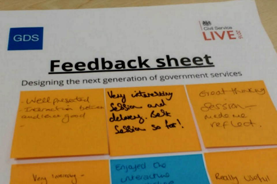 Feedback sheet with post-it notes with written comments on