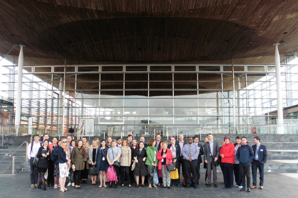 Group of men and women outside the Senedd, Cardiff