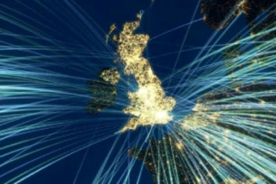 Satellite image of UK with light beams shooting out