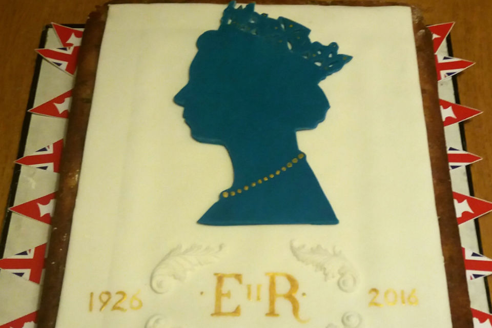 cake with Queen Elizabeth II silhouette in icing