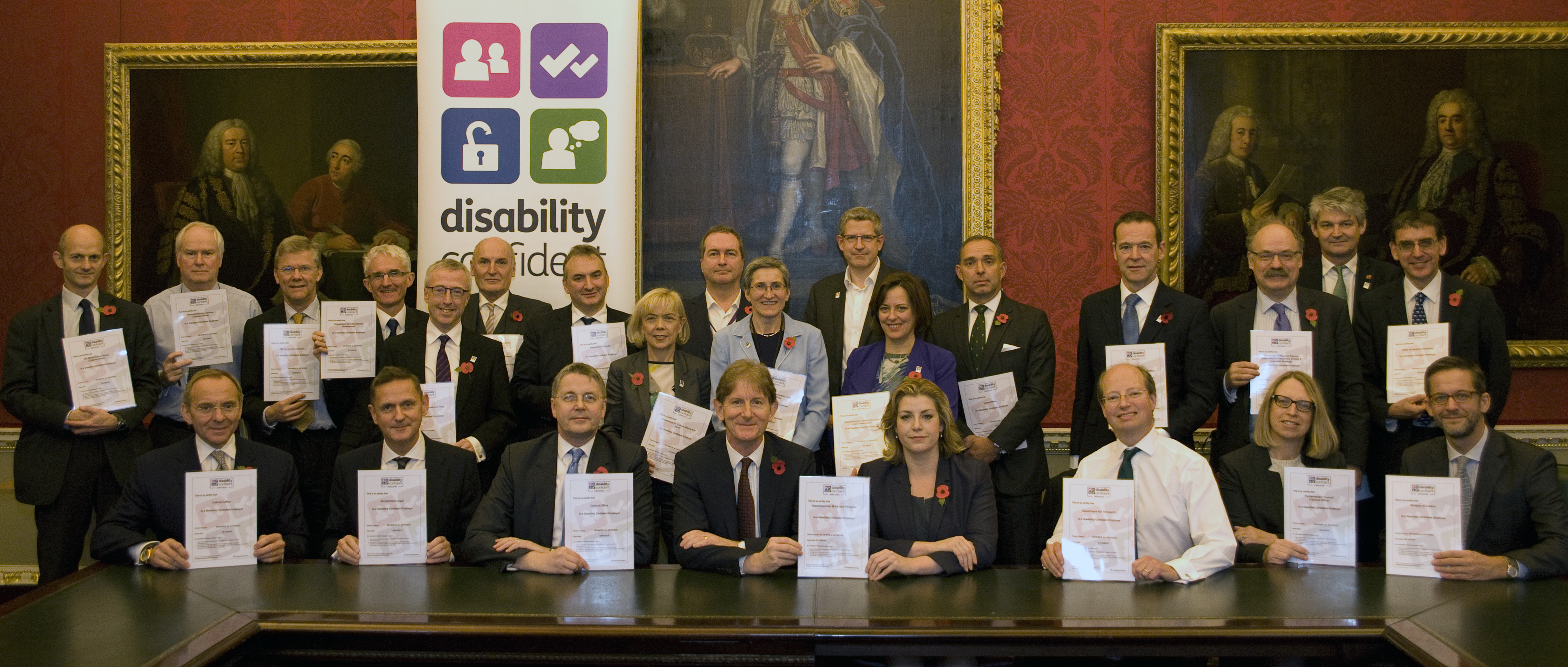 Penny Mordaunt, Minister of State for Disabled People (seated centre right) with Civil Service Permanent Secretaries, committing their departments to be Disability Confident