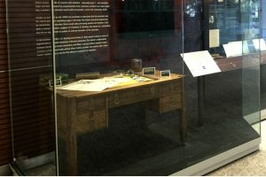 Desk in glass display case