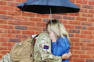 Soldier and partner under umbrella