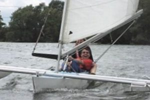 Man and woman in sailing boat