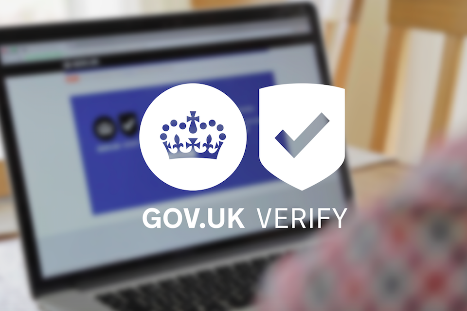 GOV.UK Verify logo superimposed on image of laptop computer and user's shirtsleeve