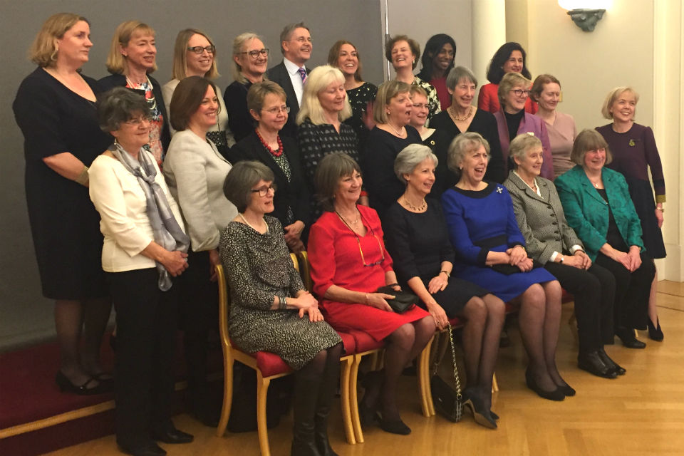 24 women and one man posing for group photo