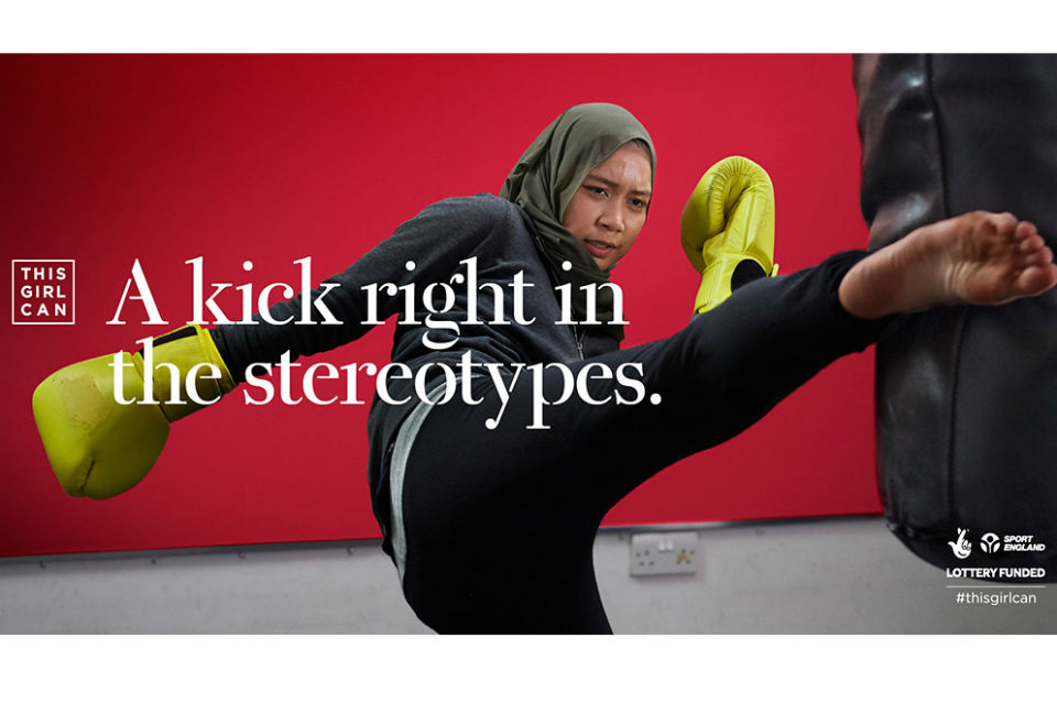 Woman kickboxer in Muslim headscarf